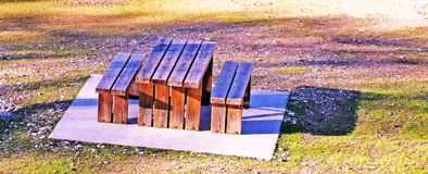 Wooden table and chairs in a campsite. To eat royalty free stock photos