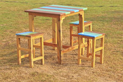 Wooden table and chairs in garden Royalty Free Stock Photos