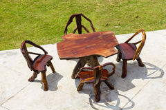 Wooden table and chairs in garden Royalty Free Stock Photography