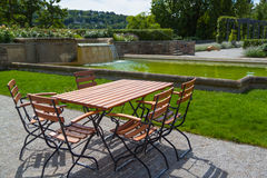 Wooden table and chairs in  park Royalty Free Stock Images