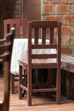 Wooden table and chairs Stock Photos