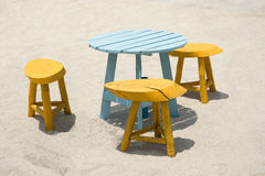Wooden Table and chairs Set  on beach sand Royalty Free Stock Image