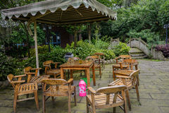 Wooden table and chairs in verdant summer Royalty Free Stock Images