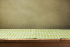 Wooden table with checked green tablecloth Royalty Free Stock Photo
