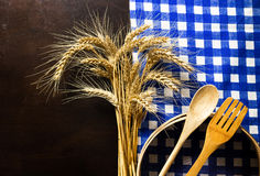 Wooden table with checked tablecloth ,wooden kitchen utensils,ea Royalty Free Stock Photos