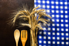 Wooden table with checked tablecloth ,wooden kitchen utensils an Royalty Free Stock Photography