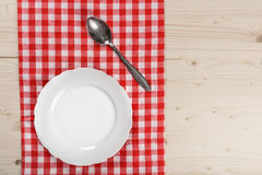 Wooden Table with Checkered Red Tablecloth Plate and Spoon. Wooden Table with Checkered Red Tableclot Stock Photography