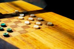 Wooden table with checkers in the games room stock images