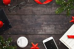 Wooden table with Christmas decorations and accessories royalty free stock photography