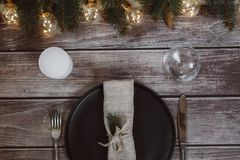 Wooden Table with Christmas decorations and garland, ware, green spruce branches. Winter flat lay royalty free stock image