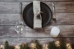 Wooden Table with Christmas decorations and garland, ware, green spruce branches. Winter flat lay royalty free stock photo