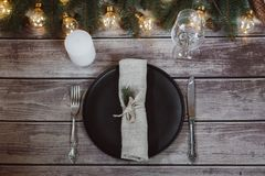 Wooden Table with Christmas decorations and garland, ware, green spruce branches. Winter flat lay royalty free stock images