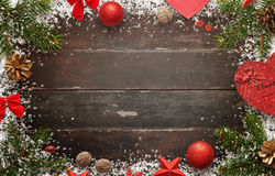 Wooden table with christmas decorations. Top view of board with free space for greeting text.  Stock Images
