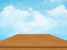 Wooden table with cloud and blue sky. Vector. Brown wooden table with cloud and blue sky. Vector illustration Royalty Free Stock Photography