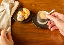 Coffee cup and cookies plate royalty free stock image