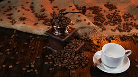 Wooden table with coffee mill full of with coffee beans stock video