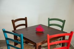 Wooden table with colorful chairs in a restaurant. stock image