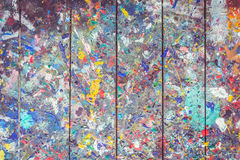 Wooden table with colorful paint spot on the surface Royalty Free Stock Photo