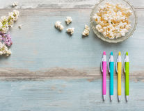 Wooden table with colorful pens Stock Photo