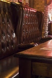 Wooden Table and Comfortable Seats in Pub Stock Image