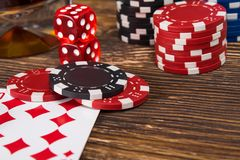 Wooden table concept of playing poker from chips and cards stock photos
