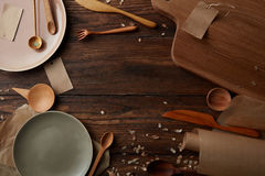 Wooden table with cooking utensils Royalty Free Stock Image