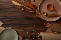 Wooden table with cooking utensils. Various wooden cooking utensils with place for text Royalty Free Stock Photos
