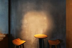 Wooden table in the corner of coffee shop royalty free stock image