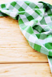Wooden table covered with green tablecloth Stock Photo