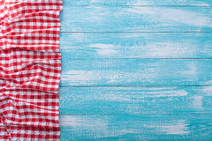 Wooden table covered with tablecloth cloth checkered red. Stock Photo