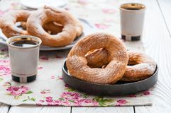 On a wooden table, curd rings on a plate royalty free stock image