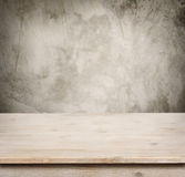 Wooden table on defocuced vintage wall background Stock Images