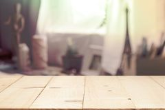 Wooden table on defocused a girl diy something with curtain window and stationery box. For montage product display or design key visual layout Stock Photos