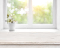 Wooden table on defocused summer window with flower pot background Stock Photo