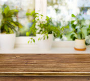 Wooden table on defocused windowsill background