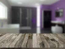 Wooden table with defocussed bathroom image Royalty Free Stock Photos