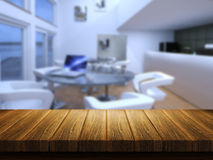 Wooden table with defocussed cafe bar image Royalty Free Stock Images