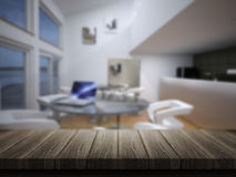 Wooden table with defocussed cafe bar image Stock Images