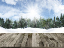 Wooden table with defocussed christmas snowy landscape in the ba Stock Photo