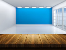 Wooden table with defocussed empty room image Royalty Free Stock Photography