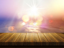 Wooden table with defocussed image of sunset ocean Stock Image