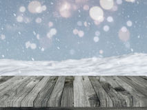 Wooden table with defocussed snowy landscape Royalty Free Stock Image