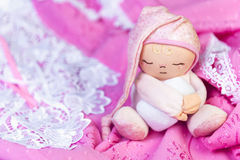 On a wooden table delicate pink nightgown with lace and soft toy Royalty Free Stock Photo