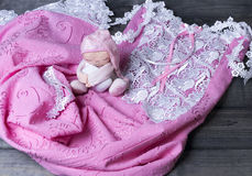 On a wooden table delicate pink nightgown with lace and soft toy Royalty Free Stock Image