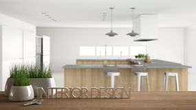 Wooden table, desk or shelf with potted grass plant, house keys and 3D letters making the words interior design, over professional royalty free illustration