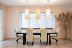 Wooden table in dinning room Royalty Free Stock Photos