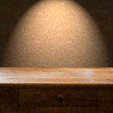 Wooden Table Backdrop. Wooden table with drawer and light backdrop Stock Photography