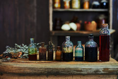 Wooden table, dried herbs and bottles, a top view, in the studio, in the afternoon. Wooden table with dried herbs and bottles, a top view, in the studio, in the Stock Photo