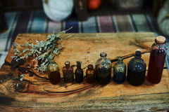 Wooden table with dried herbs, bottles, a top view, in the studio, in the afternoon. Royalty Free Stock Photos