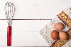 Wooden table, eggs and tablecloth Stock Image
